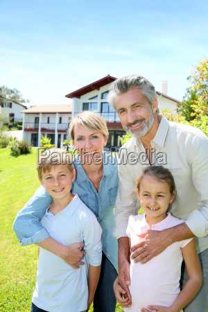 happy family standing in home private
