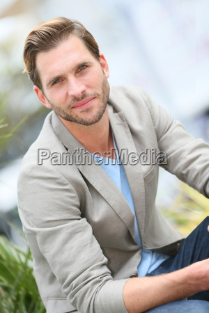 handsome guy sitting in the street