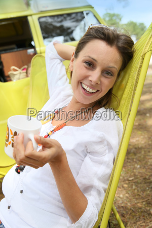 portrait of cheerful woman relaxing in