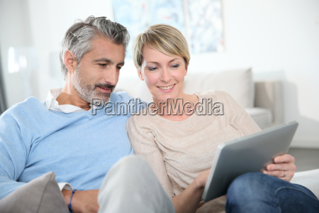 middle aged couple websurfing on internet