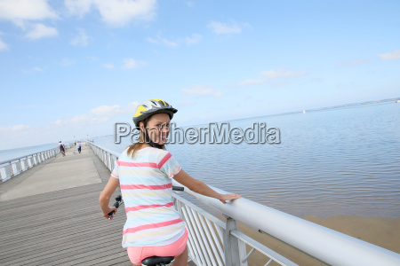 portrait of young woman riding bike