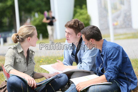 young people sitting in park to