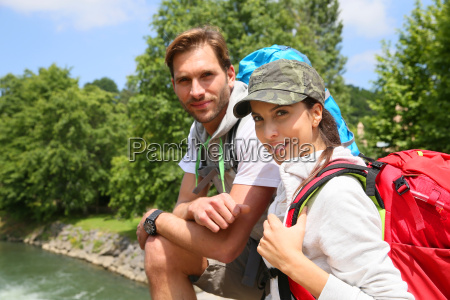 portrait of cheerful couple of hikers
