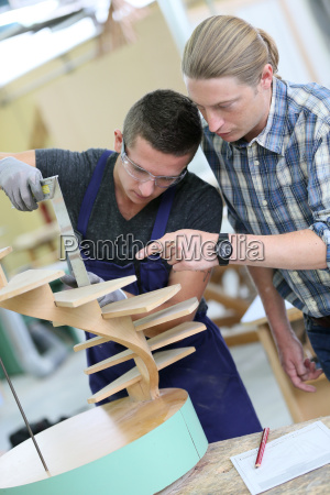 apprentice with adult in carpentry school