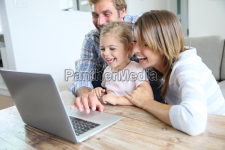 parents with little girl laughing in