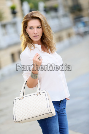 active mature woman walking in town