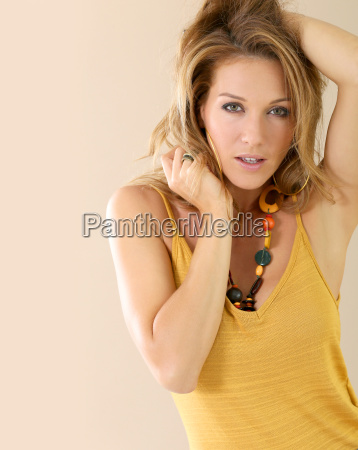 attractive blond mature woman model beige