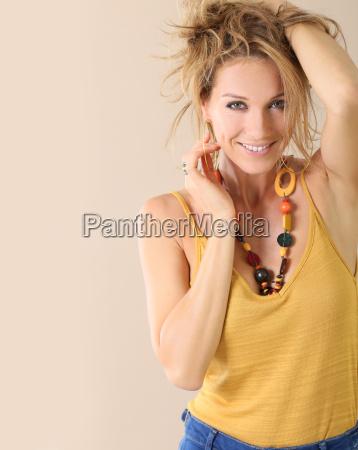 attractive blond mature woman model beige