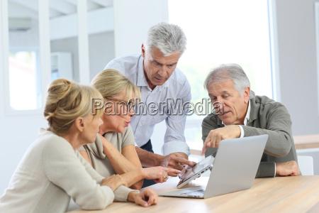 group of retired senior people using