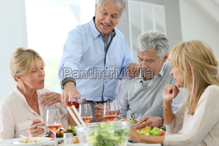 group of senior people having lunch