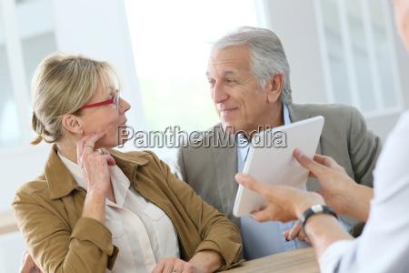 senior woman at optical store choosing