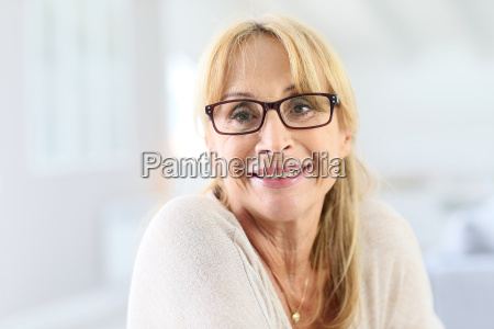 portrait of elderly woman with eyeglasses