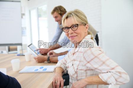 portrait of senior woman attending business