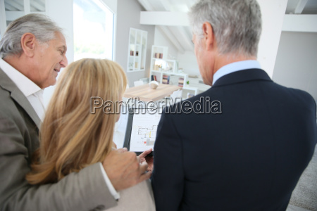 senior couple with real estate agent