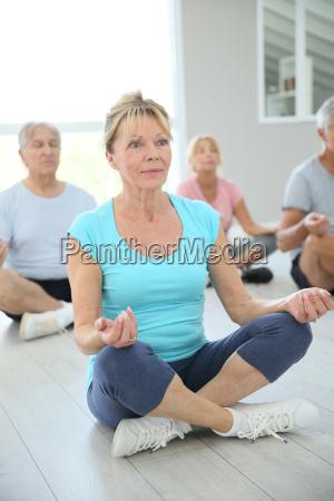 group of senior people doing yoga