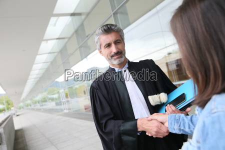 lawyer meeting client in courthouse before