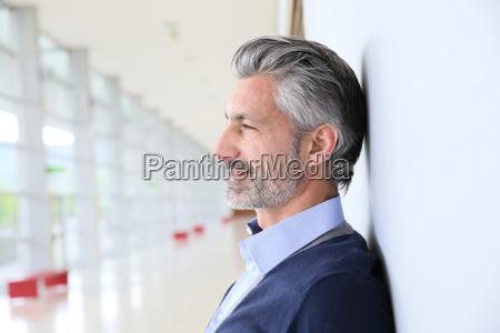 portrait of smiling mature man standing