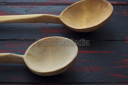 two empty wooden spoon