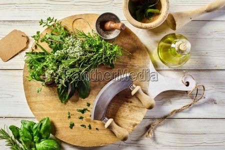 mezzaluna knife with assorted fresh herbs