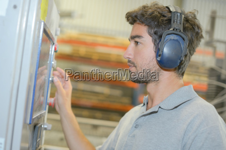 man with ear protection