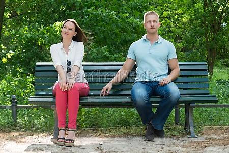shy man flirting with woman on