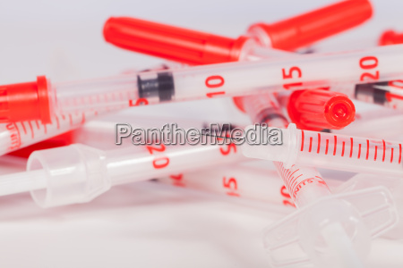 small syringes with injection needles and