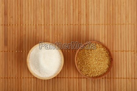white and brown cane sugar in