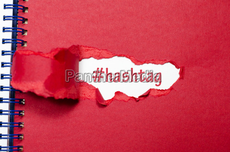 the word hashtag appearing behind torn