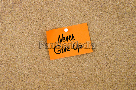 never give up written on orange
