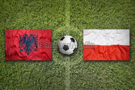albania vs poland flags on soccer