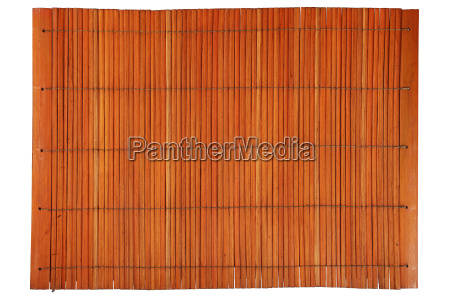 orange brown vintage bamboo mat isolated