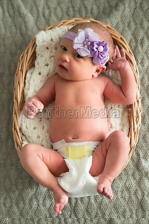 baby wearing purple headband