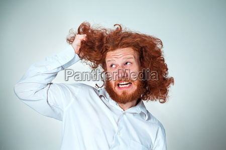 the angry man tearing his hair