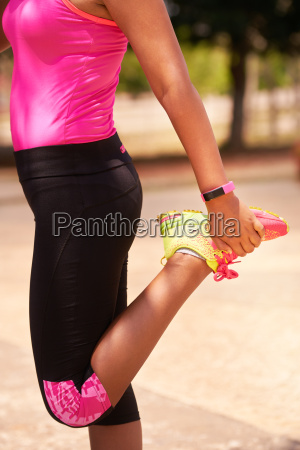 woman sports stretching using fitwatch steps