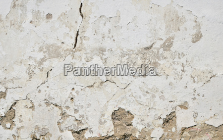 old white painted plaster wall with