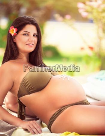 pregnant female on the beach