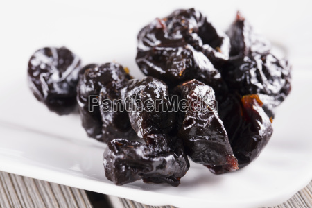 prunes over white plate