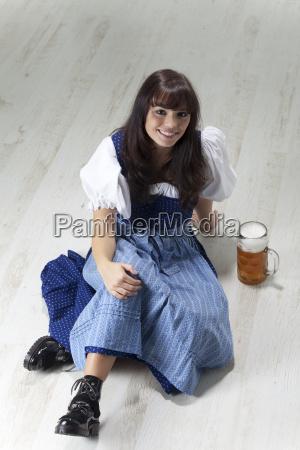 young bavarian woman with beer