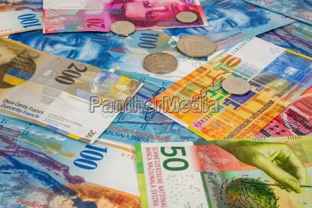 swiss franc banknotes and coins as