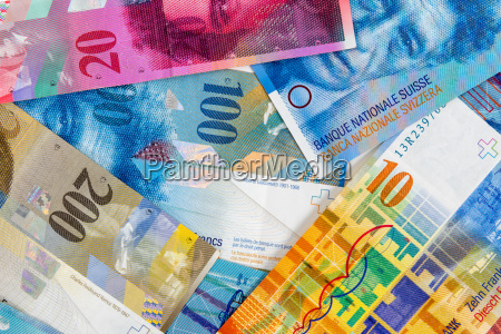 swiss franc banknotes as background