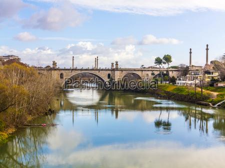 old bridge spans river tiber