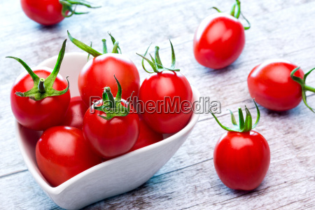 party tomato with porcelain bowl