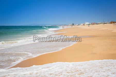 beach of faro algarve portugal