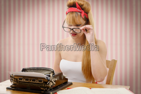 pinup girl with old typewriter