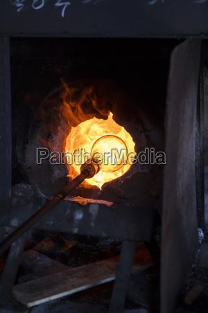 glass heated in a furnace in