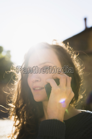 portrait of smiling woman telephoning with