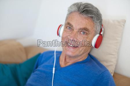 portrait of smiling senior man wearing