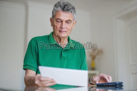 senior man sitting at desk with