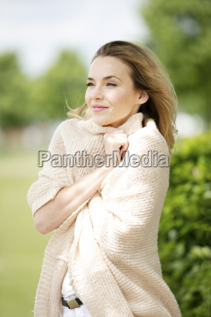 portrait of smiling blond woman dressed