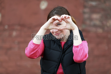 woman showing heart